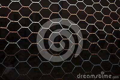Closeup picture of a rusted wire fence