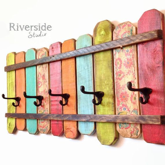 This is a unique wood coat rack with cast iron hat and coat hooks. A cheerful display hand painted in lime green, orange, blues, bright red and floral, then distressed and protected. I make these colourful racks from reclaimed wood in my woodshop and each one has unique character and charm. The back has 2 strong metal keyhole hardware (60lbs each) already attached 16 apart. These gorgeous racks are perfect for the bathroom, bedroom, or near the back door. You choose from 2 sizes at checkout…