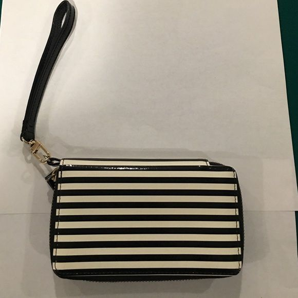 Wristlet / iPhone 4/5 case This is a great patent leather wristlet. It can hold an iPhone 4 or 5 and it has 3 credit card slots, 1 clear slot and a pocket. It measures 6 inches by 3 inches. Halogen Bags Clutches & Wristlets