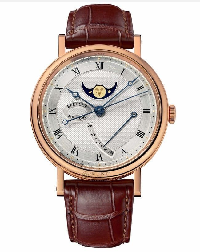 Breguet Classique Power Reserve 7787BR/12/9V6.Classique Moon Phases wristwatch in 18-carat rose gold, 39 mm diameter. Self-winding movement. Dial in silvered 18-carat gold, hand-engraved on a rose engine. Chapter ring with Roman numerals. Age and phases of the moon at 12 o_جø¬_clock. Power-reserve indication at 3 o_جø¬_clock. Open-tipped Breguet hands in blued steel.