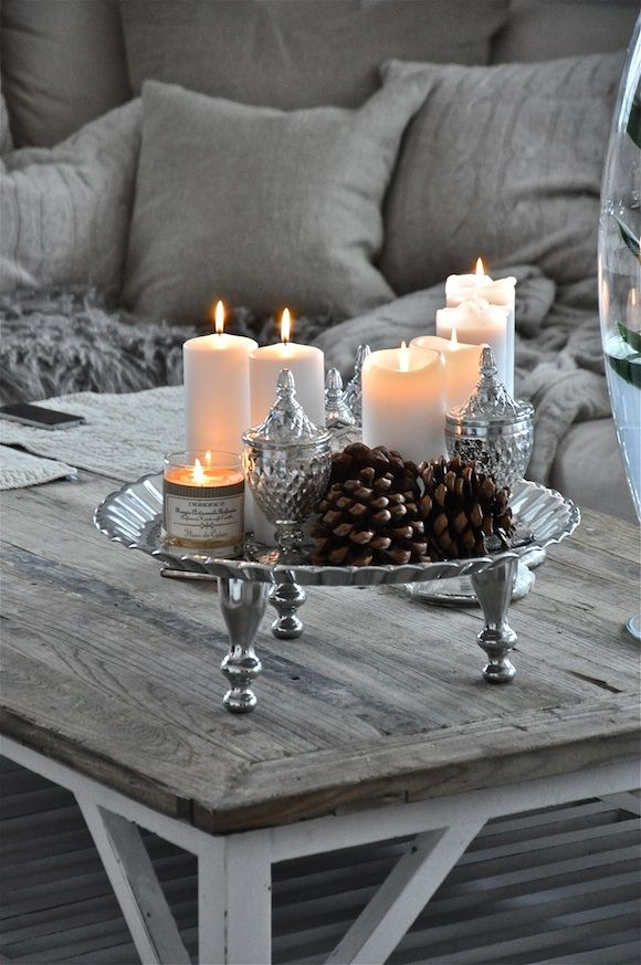 Love the silver, candles and pinecones..can leave it out all winter...also a pretty New Years tablescape.