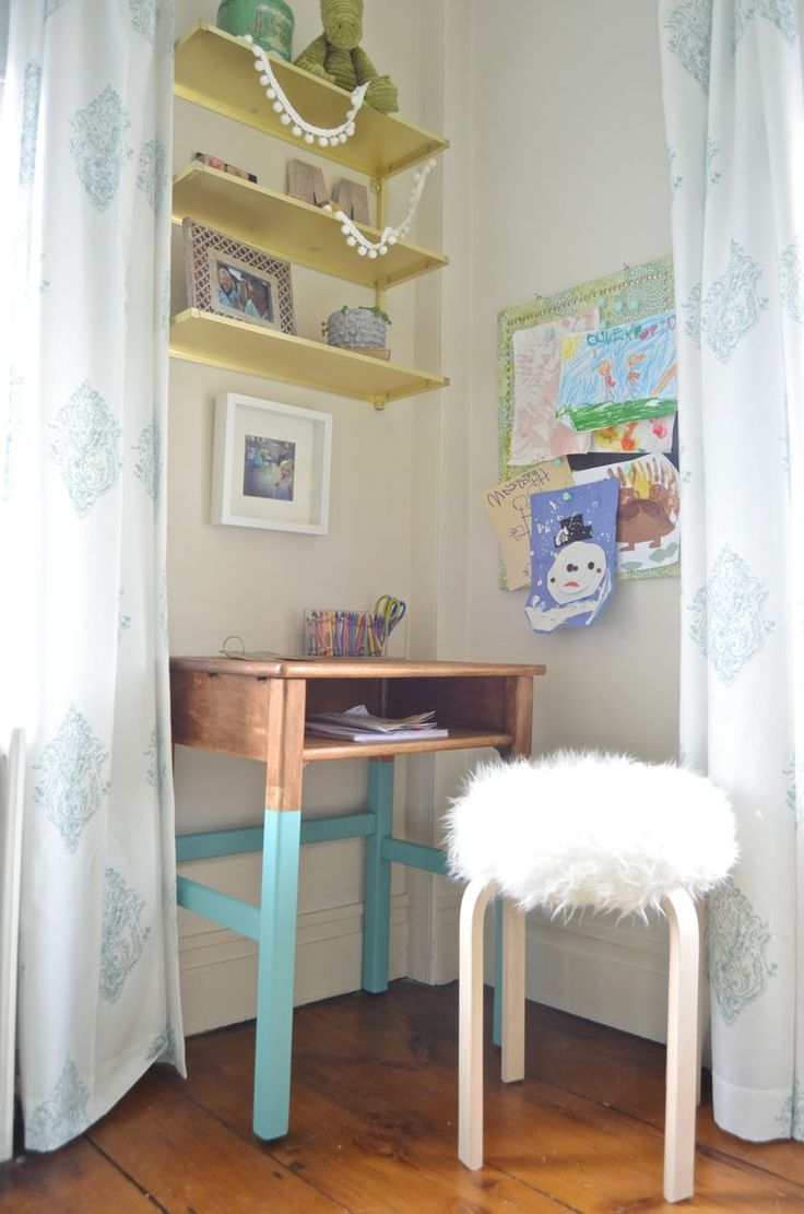 Adorable kid's desk area in a small space. Great use of space! Love the dip-dyed look on the little desk.