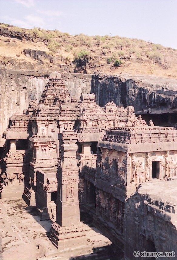 Ellora Caves represents the epitome of Indian rock-cut architecture. A complex of 34 monasteries and temples, they were dug side by side in the wall of a high basalt cliff, between the 5th and 9th centuries.