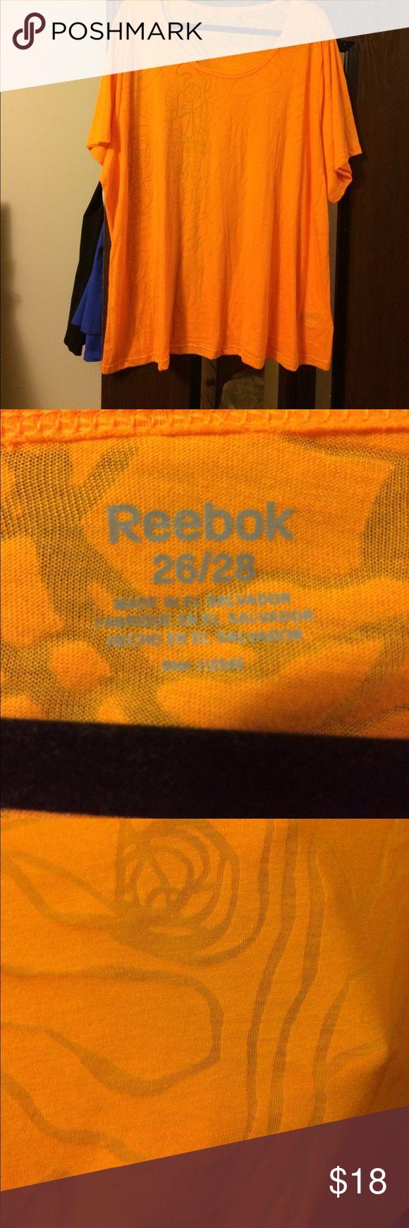 Reebok Orange Tee Reebok Orange Tee, size 26/28.  Sheer in some parts of pattern.  Never worn Reebok Tops Tees - Short Sleeve