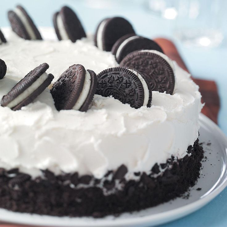 Cookies-and-Cream Cake Recipe -If you like cookies-and-cream ice cream, you'll love this cake. Chocolate sandwich cookies are mixed into the batter and pressed into the sweet and creamy frosting for a fun look. —Pat Habiger, Spearville, Kansas