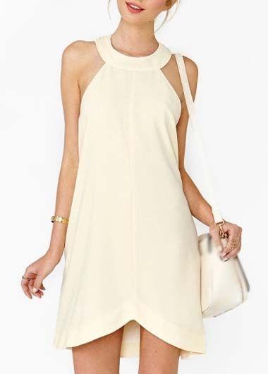 love the neckline on this cream dress