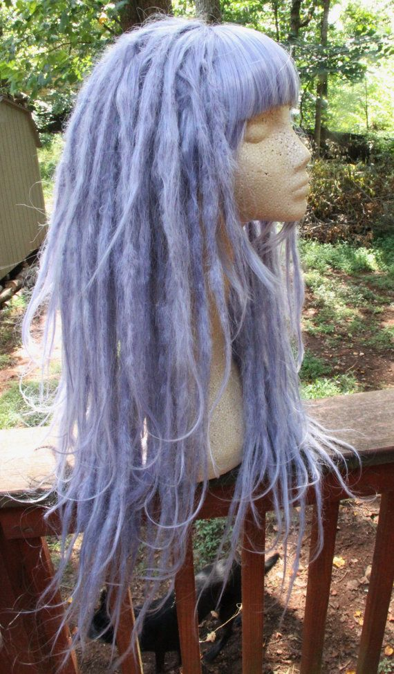 READY TO SHIP!! Pastel Lavender Blue Synthetic Dreadlock Wig!  This wig is hand dreaded with twist and rip method, then steam sealed for clean appearance and stable construction. The wig is fully dreaded with some sparse loose hairs in the body for a natural appearance  Details: ~ VERY thick and full! ~ Approximately 24 with long asymmetrical layers ~ hand dreaded with twist and rip method ~ Locked with a steamer for clean, mature appearance ~ Heat resistant to low/medium setting *use…