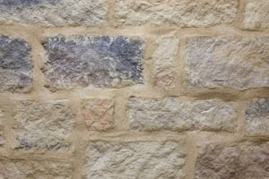 Overgrout Joint Technique gives a rustic old world appearance. An overgrout is achieved by completely filling the joints and overlaying some of the stone with excess mortar.