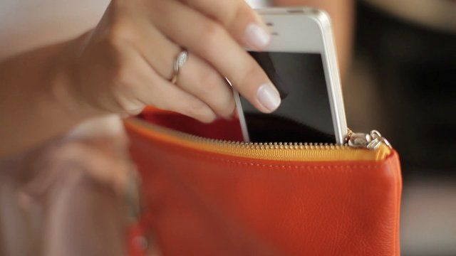 Everpurse has a special charging pocket into which you place your smartphone. Our patent-pending docking system guides your phone smoothly onto a dock connector at the bottom—so you don't have to fish for a cord! To charge Everpurse itself, you can simply place Everpurse on its charging mat.
