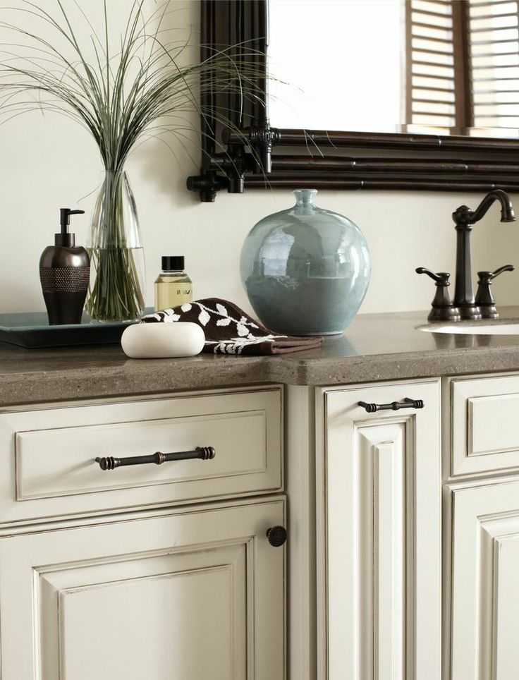 Charlotte collection in Satin Copper on ivory cabinets. LOVE