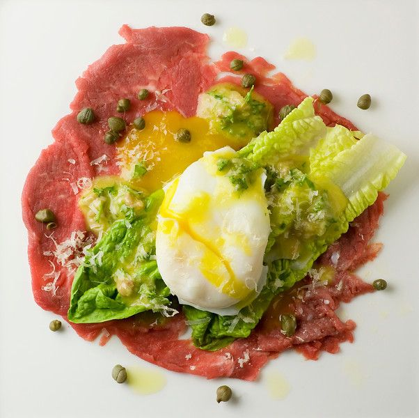 Filet Mignon carpaccio with mini Ceasar salad and poached egg