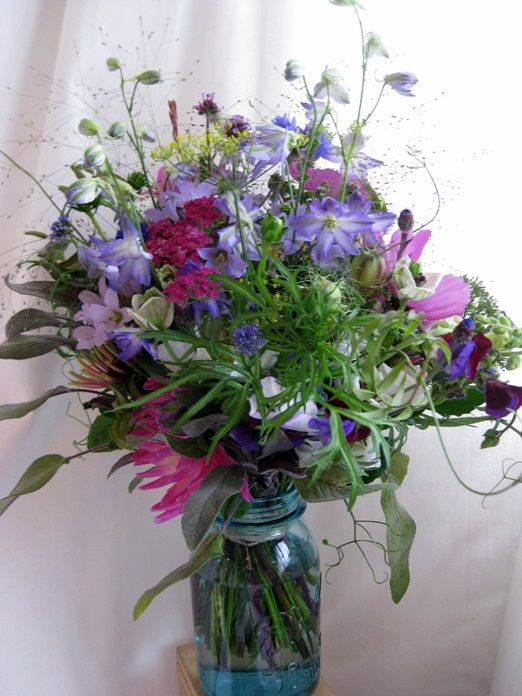 These are the colours in the bouquets so thought dresses could range from deep purples, maroons to light blues and greys?