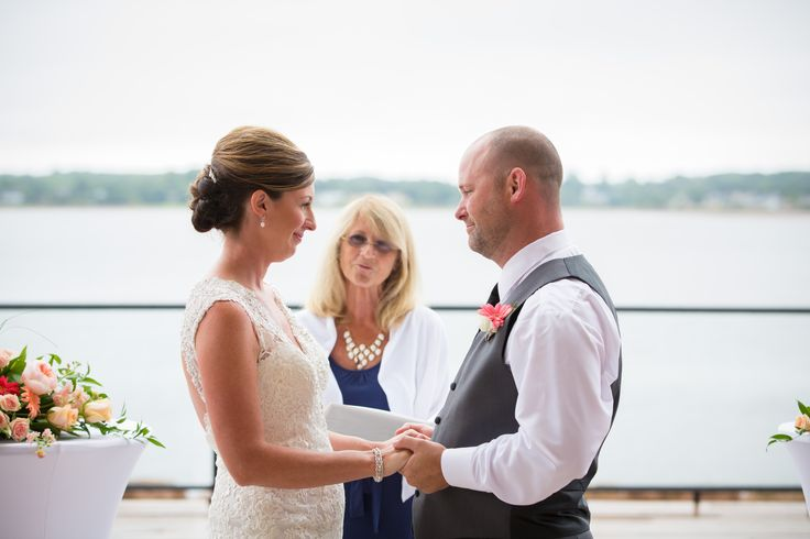 Outdoor ceremony on the deck at the Prince Edward Island Convention Centre & Delta Hotel. Photo by Brady McCloskey Photography #PEIweddings #weddings #PrinceEdwardIsland