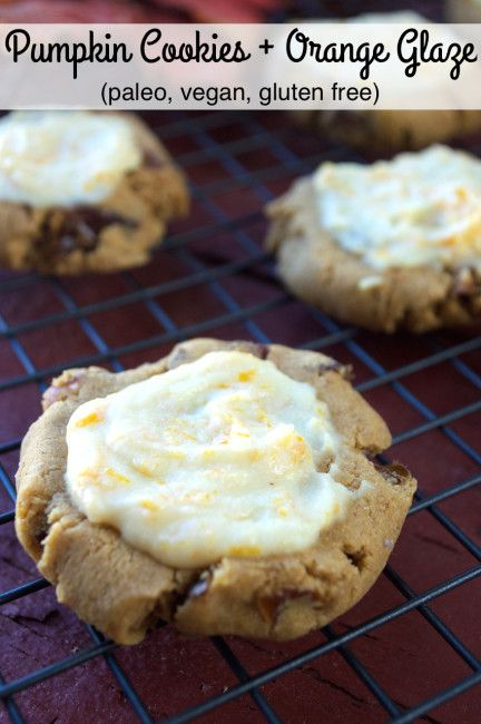Paleo, Vegan Pumpkin Cookies with Orange Glaze. These cake-like cookies are filled with dates and pecans and topped with a dairy-free citrus glaze.