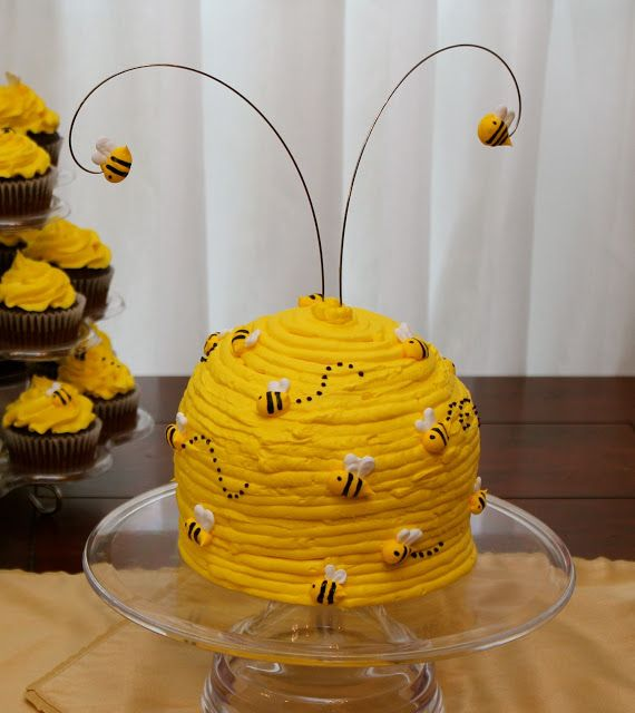 "How to make a ""Bee Hive"" cake. Instructions at the bottom of the blog post. They use it at a Gender Reveal Party!"
