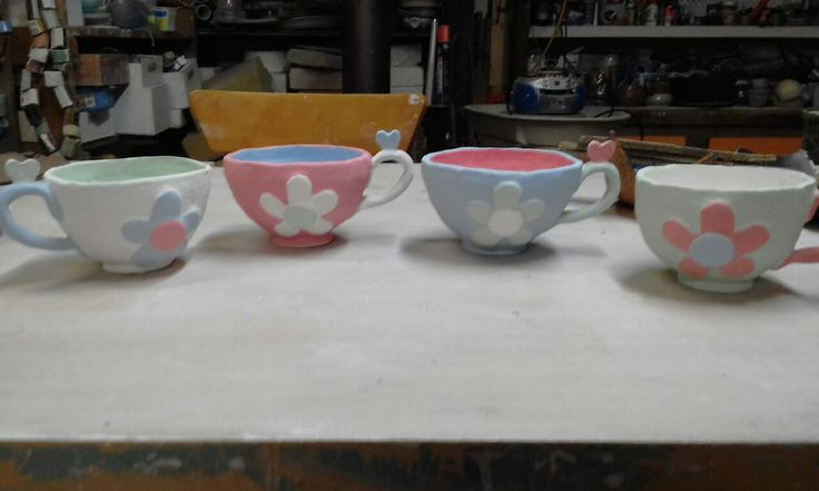 4 teacups ready for last fire