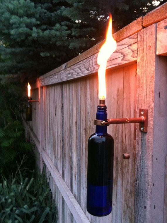 #lighting #torches #backyard #bbq #party #decorCitronella Oil, Empty Wine Bottles, Outdoor Lighting, Wedding Ideas, Flower Baskets, Wine Bottle Torches, Wine Taste, Tiki Torches, Outdoor Weddings