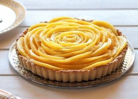 This Mango Tart uses fresh, ripe mangos and coconut cream to make a delicious dessert that's also gluten-free, Paleo, and vegan!