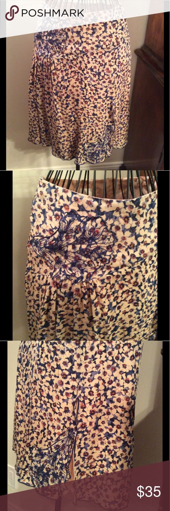 "Anna Sui 100% silk skirt. Anna Sui 100 % silk skirt. Beautiful flower embroidery in dark blue. Beige lining in acetate. Length 22"" top width 13.5"" middle width 21"". No signs of wear. Made in USA Anna Sui Skirts"