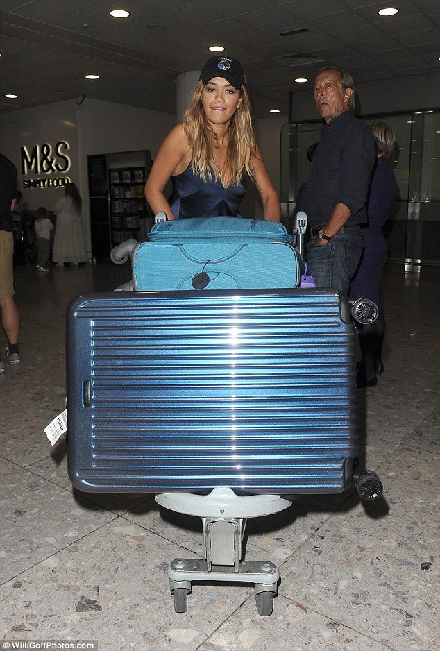 Travelling light: Rita lugged her suitcases through customs showcasing her rather large wardrobe