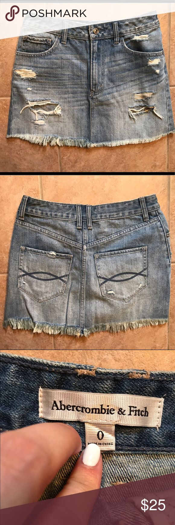 Abercrombie and Fitch Denim Skirt Abercrombie and Fitch Destroy Wash Denim Skirt. Size 0. Never Worn. Abercrombie & Fitch Skirts