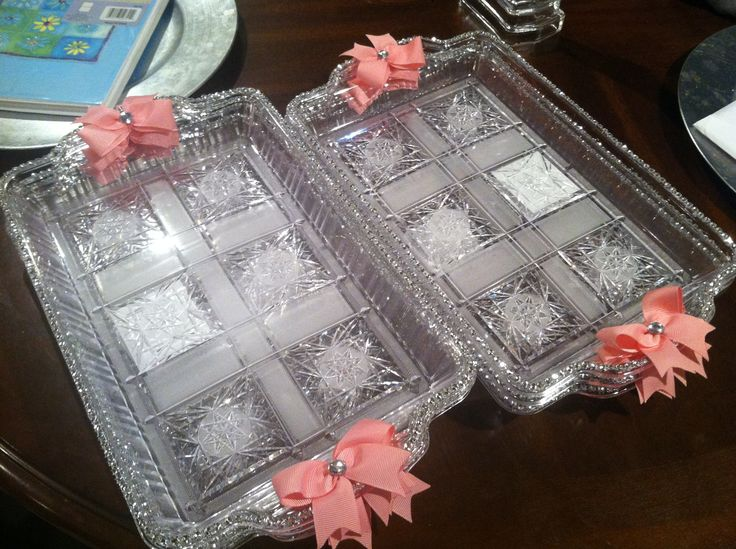 Plastic dollar tree tray decorating for a baptism party .   Hairbows on sides. Plastic rhinestone for trim all around.