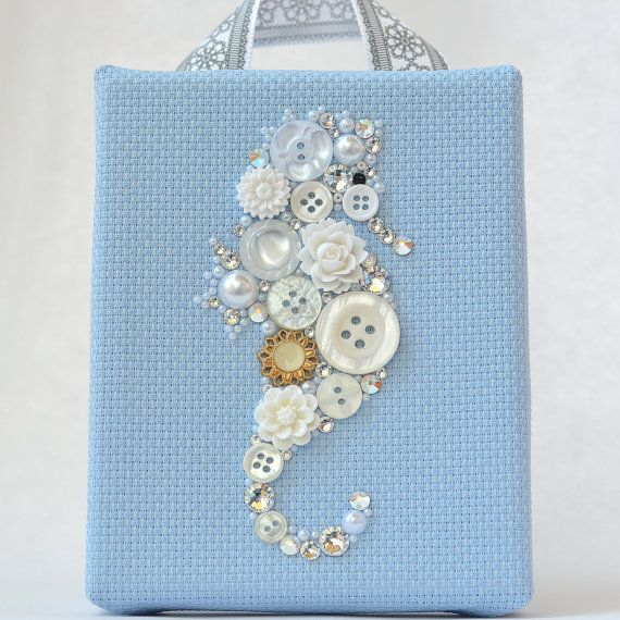 Title: Under the Sea - White Seahorse    This beautiful piece has been created on a sturdy 5x4 wooden frame wrapped with a high quality blue