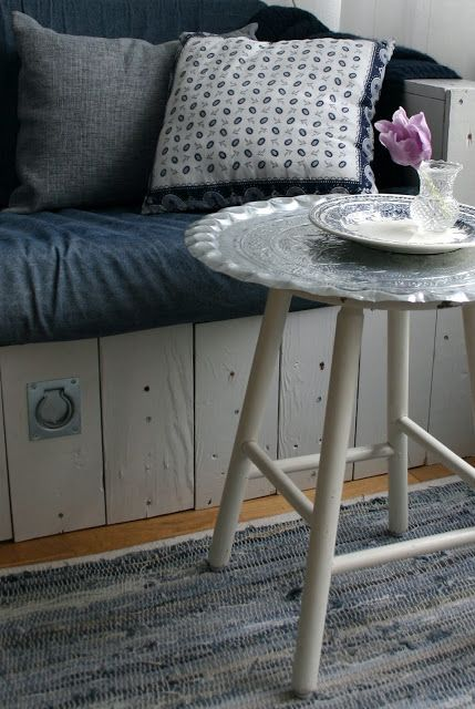vintage silver platter mounted onto legs from an old stool = side table