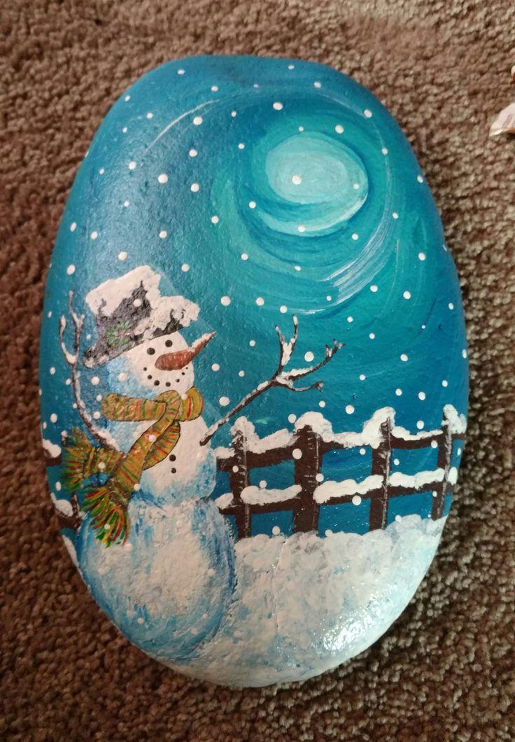 Snowman enjoying a full moon. Painted rock.