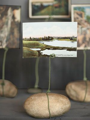 Use those outdoor stones to make a cute, rustic photo or note display...a rock and some wire, so cheap & cute!