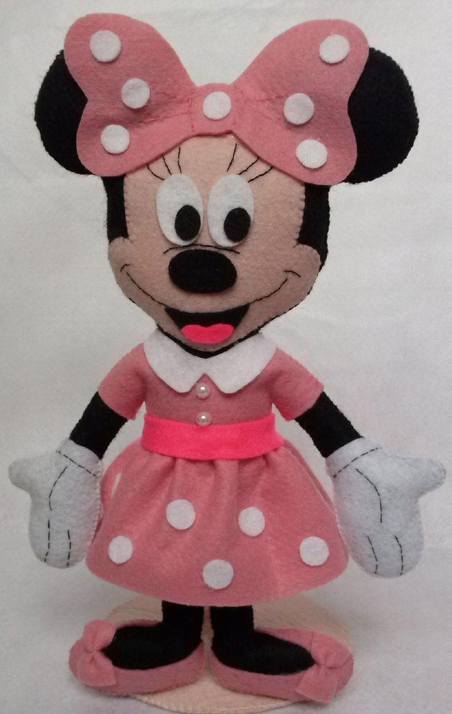 Minnie Mouse em pé. <br>Vermelha ou rosa.