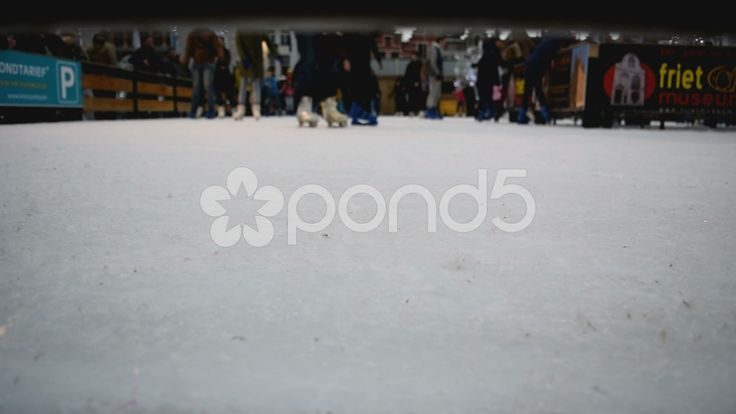 Ice skating. View of people's feet from ground level. Blurred. Bruges, Belgium - Stock Footage | by glenman77