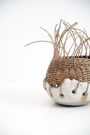 I love the idea of adding a pottery base to this hand woven basket! What a contrast of natural elements!