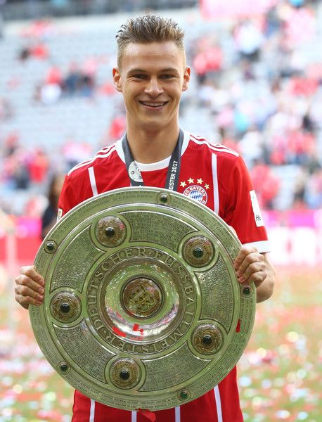 Joshua Kimmich of Bayern Muenchen poses with the trophy following the Bundesliga match between Bayern Muenchen and SC Freiburg at Allianz Arena on May 20, 2017 in Munich, Germany.