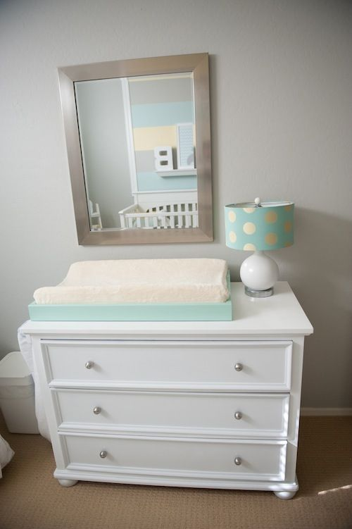 Cute dresser, changing pad, lamp, mirror. Done.