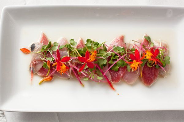 Amberjack, Golden eye snapper and tuna belly crudo Micro Arugula & MicroFlowers™ Orchid