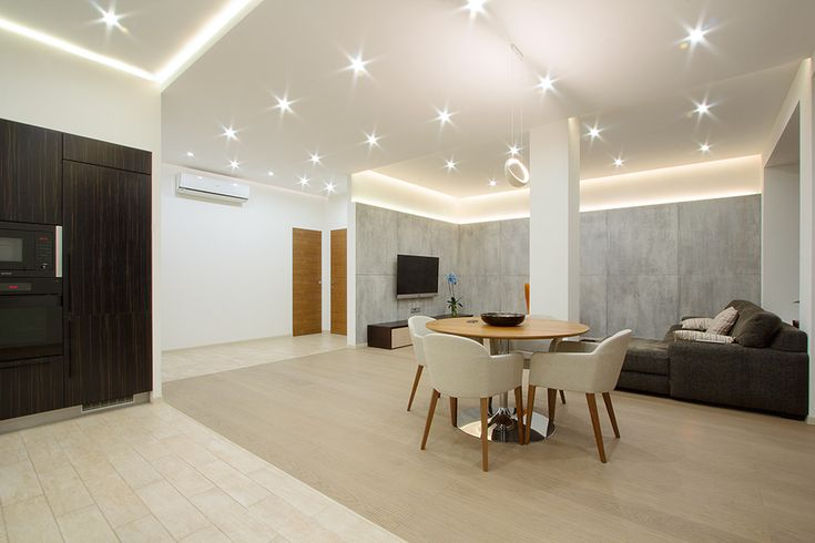 Open Modern Studio Apartment Dining Space Furnished Among Round Dining Table Coupled With White Chairs