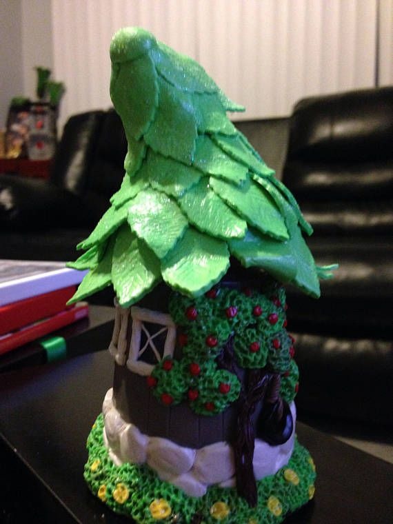 Miniature fairy house made of polymer clay decorated jar