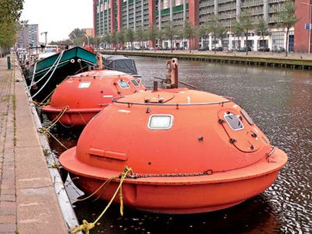 "Survival Pod Hotel in Netherlands  -""The Capsule Hotel, which consists of oil rig survival pods, is located on a canal in Amsterdam."""