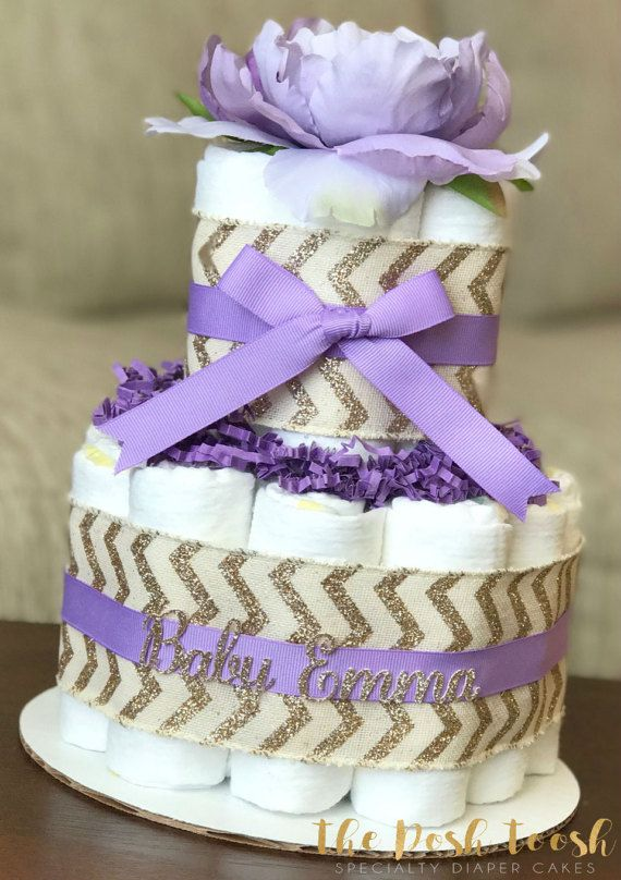The Posh Toosh Specialty Diaper Cakes make perfect baby shower centerpieces and décor, baby shower gifts, nursery décor, and a unique and practical gift for a mommy-to-be! 2 Tier Girl Lavender Purple and Gold Floral Chevron Diaper Cake