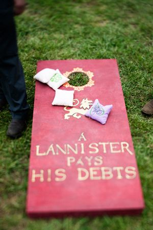 game of thrones wedding...A Lannister ALWAYS pays  his debts*is how SHOULD read* We spotted these Thrones-themed lawn games at a Southern wedding.