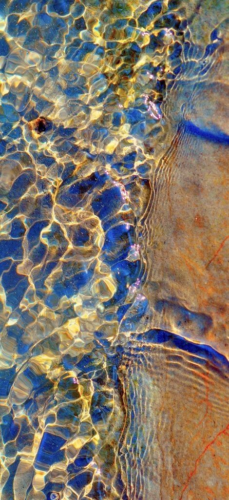 Ripples in the sea. Live the colours. Great inspiration for art and backgrounds