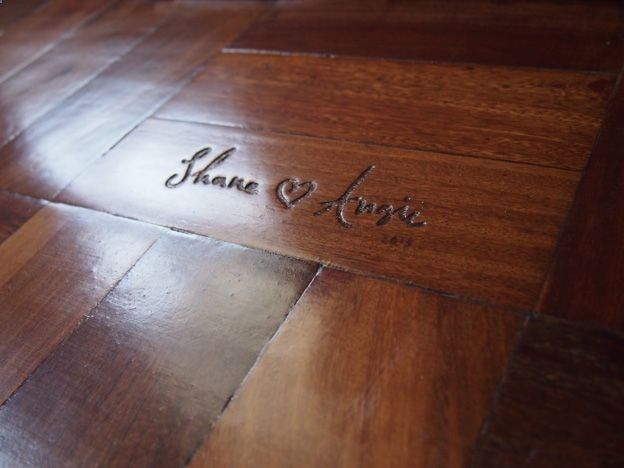 Dear future me: carve names into wood floor of house built together.