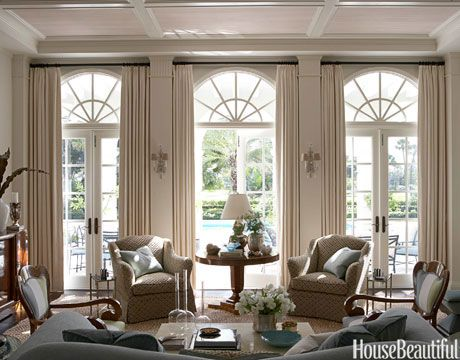 Gracious comfort was what McBournie aimed for in the living room. Simple curtains are in Henry Calvin's Gaelic Linen. On the pilasters betwe...