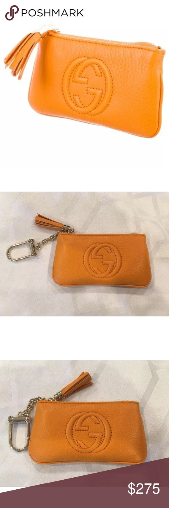 Gucci orange soho keychain pouch GUCCI SOHO KEY POUCH Orange leather Gucci Soho key pouch with gold-tone hardware, GG accent at front face, key ring at side, brown interior. Zip closure at top featuring leather tassel embellishment. Includes Gucci box! This is a great item when you don't want to carry anything with you! Your Credit Card, ID and money all fit inside! Gucci Accessories Key & Card Holders