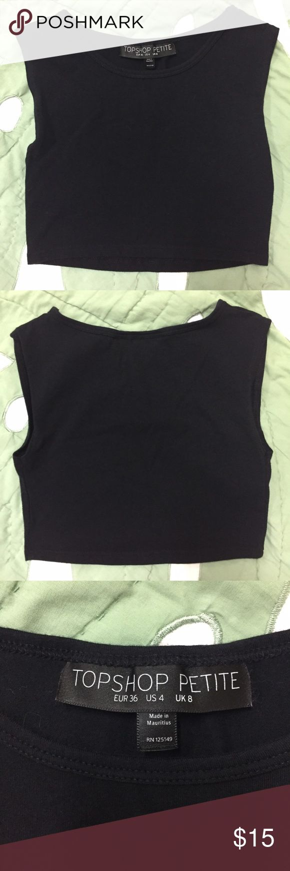 """Topshop Petite Cropped Muscle Tank in Black Worn only once. Topshop Petite cropped muscle tank in black. Approx. 11.5"""" from shoulder to hem, hits me right below the bust. In excellent condition, no rips, stains, or defects. A great basic for any closet! US size 4, but best fits an XS. 💛 Topshop PETITE Tops Crop Tops"""