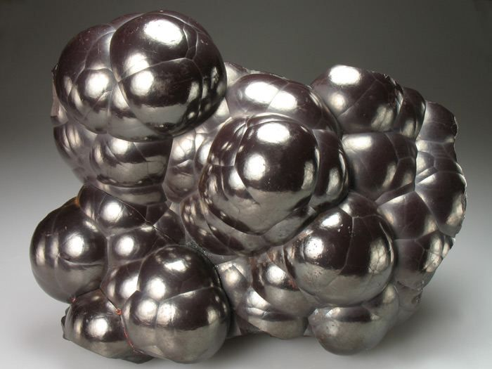A magnificent display specimen of 'kidney ore' Hematite found in the early 1900's.