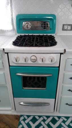 Beautiful blue vintage stove in a 1955 Terry, 21 foot. Interior - tiny trailer / Vintage Camper / Caravan
