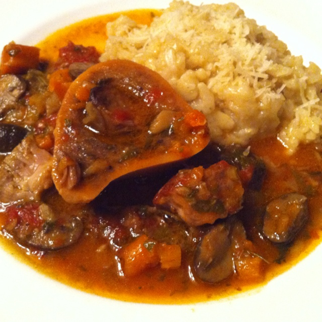 Osso Bucco made with Carrots, Mushroom, Tomato base, white Wine, and Veal Shank sliced with bone to enjoy the bone marrow on the Risotto. Classic Cipriani risotto made from Italian Arborio Rice sautéed in Olive oil and minced shallots, added 2 quarts of chicken stock, plus butter and Parmesan at the end of cooking. Buon'Appetito !:)