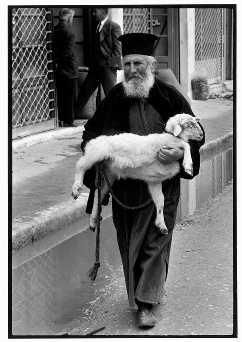 Constantine Manos 1964 GREECE. Crete. 1964. Priest in town on market day.